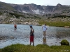 Cold snow melt pond on top of Grassy Pass
