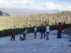 Sledding on the mountainside in the summer snow